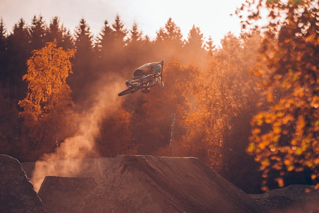 Rider jumping dirt jumps